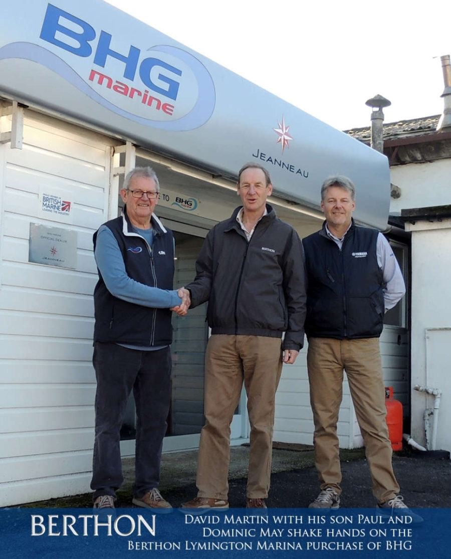 Domin May of Berthon Lymington Marina flanked by David and Paul Martin, shakinghands on the deal to purchase BHG and Willow Marine