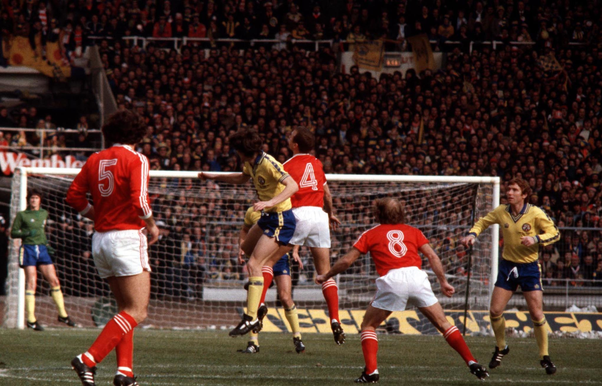Nottingham Forest skipper John McGovern challenges for the ball with Steve Williams (yellow top) as Saints captain Alan Ball looks on
