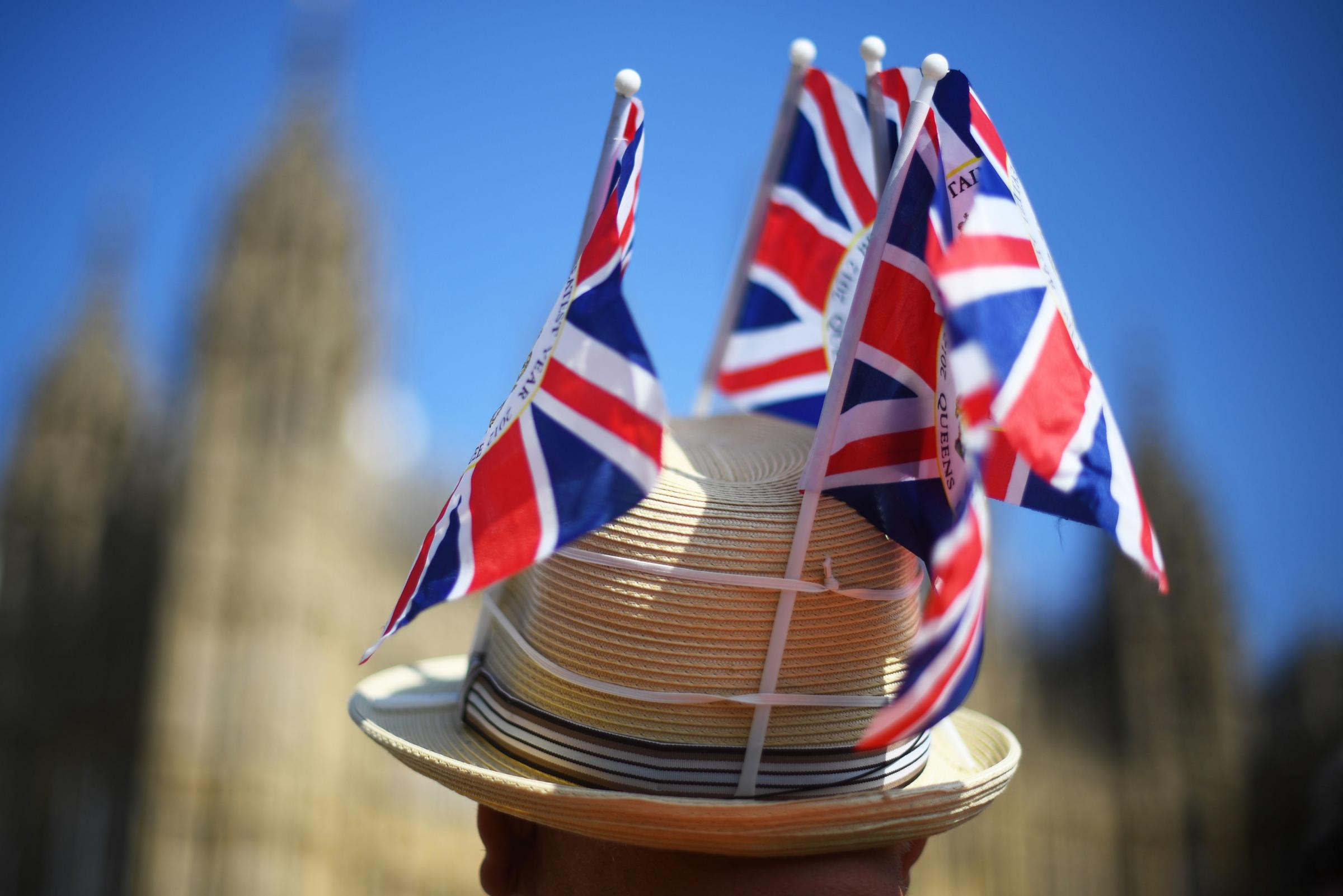A protester wearing a hat adorned in Union flags outside Westminster, London, as MPs are expected to consider and vote on a Government motion on the EU withdrawal on Friday evening. PRESS ASSOCIATION Photo. Picture date: Friday March 29, 2019. See PA sto
