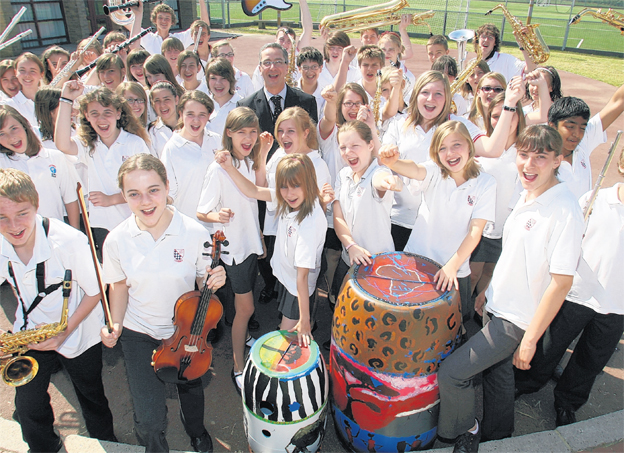 Head teacher Matthew Longden with the Toynbee school band, who are off to Germany