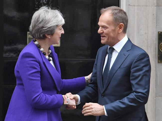 File photo dated 01/03/18 of Prime Minister Theresa May and European Council president Donald Tusk at Downing Street, London. Theresa May is to write to Donald Tusk today with the UK's request for a further delay to Brexit, as the European Council pr