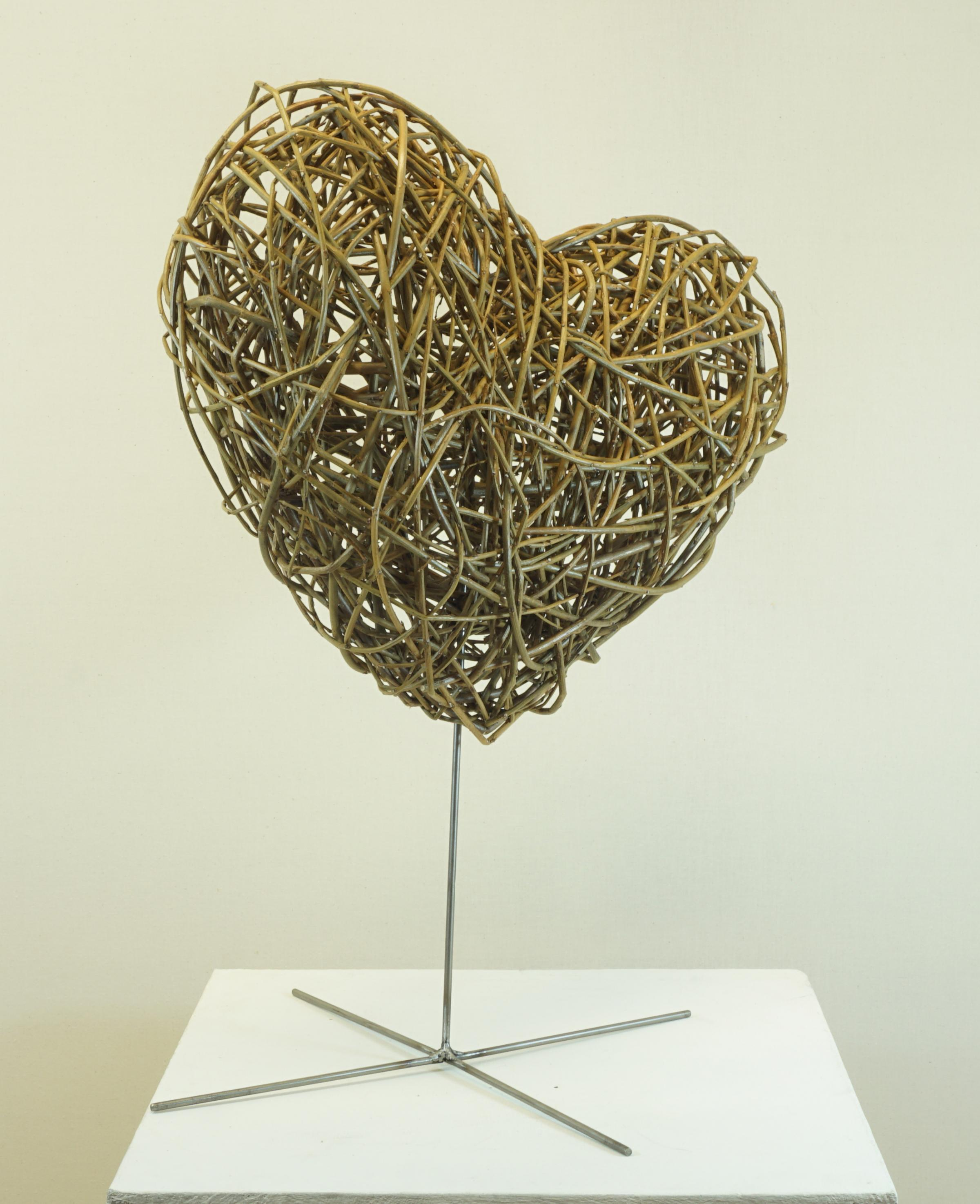 Create a large willow heart sculpture