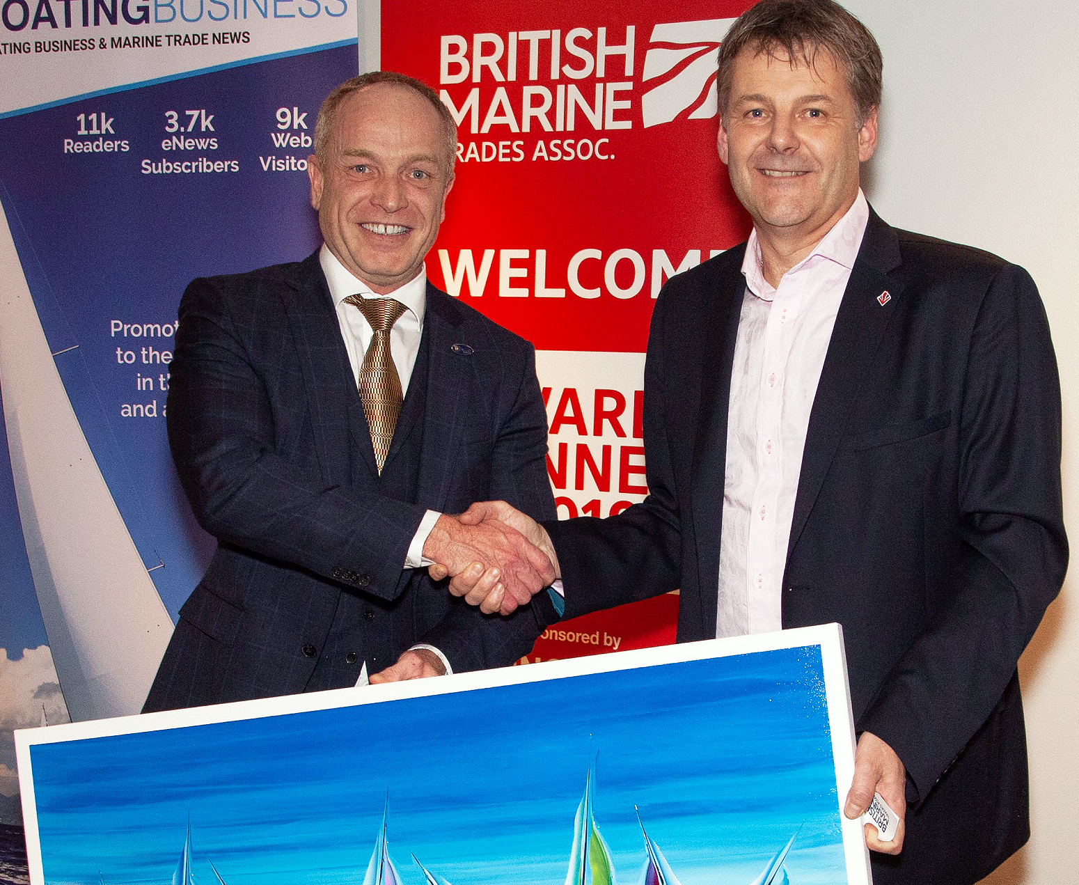 Richard W. Roberts receives his award from Paul Martin, chairman of the British Yacht Federation