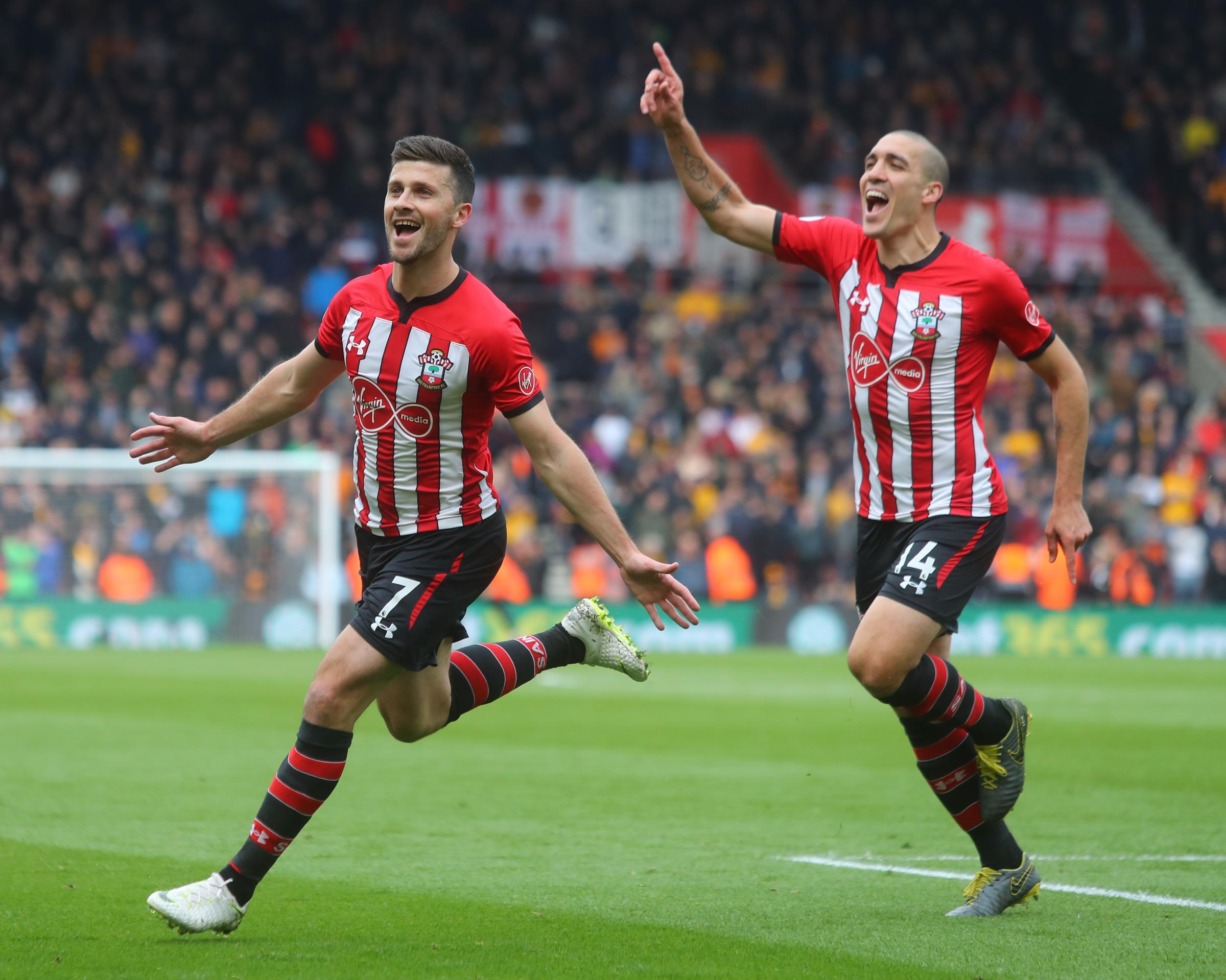 Shane Long celebrates with Oriol Romeu