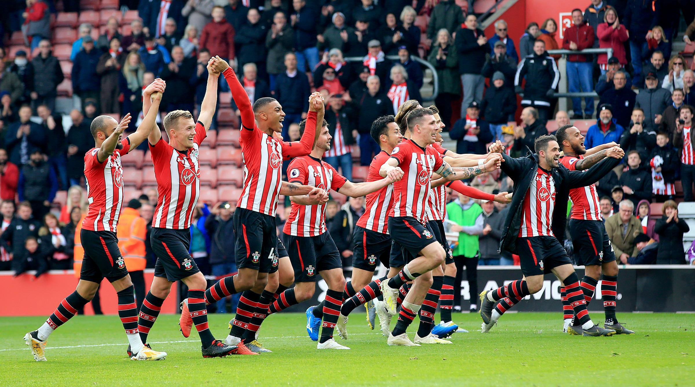 Saints celebrate in front of the fans after the Wolves win