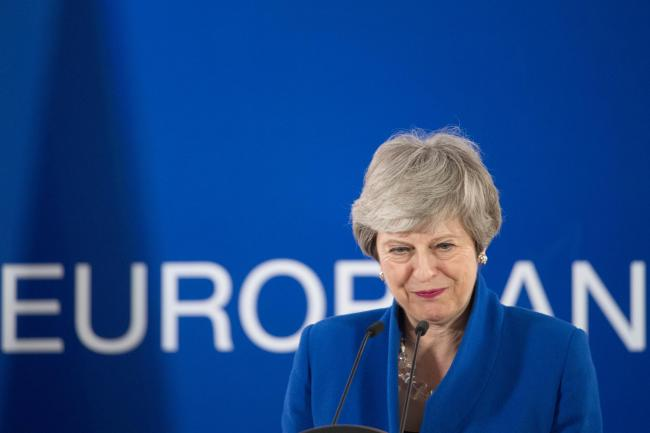 Theresa May after the European Council in Brussels earlier this year. Photo: Stefan Rousseau/PA Wire.