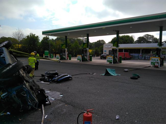 PHOTO: Car overturns in Hampshire petrol station