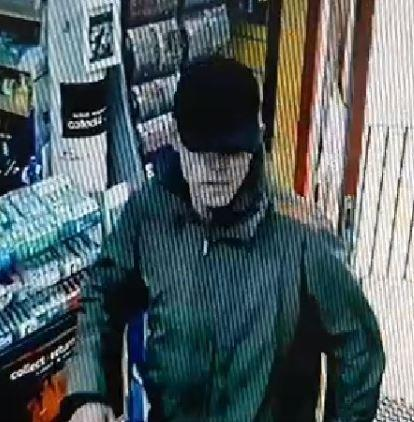A CCTV still of a man wanted by police.