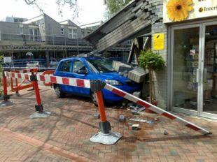 The blue Mazda which crashed into The Flower Shop