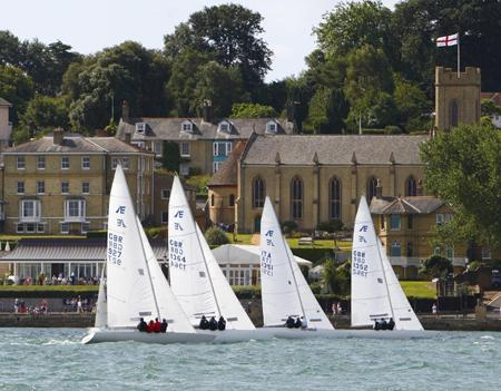 The Etchell fleet heads past Holy Trinity church on their first leg.